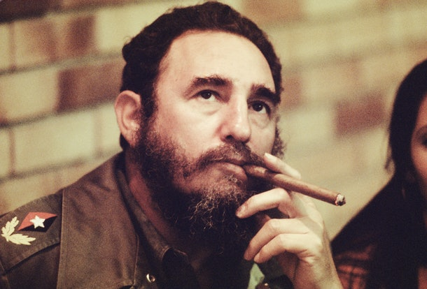 HAVANA, CUBA -- CIRCA 1977: Fidel Castro smokes a cigar in his office in Havana, Cuba, circa 1977. (Photo by David Hume Kennerly/Getty Images)