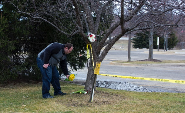KALAMAZOO, MI - FEBRUARY 21:  A man places flowers at a Cracker Barrel where a gunman went on a shooting rampage, on February 21, 2016 in Kalamazoo, Michigan. Authorities said that a shooter who killed six people and injured two others was an Uber driver who appears to have gunned down people at random during a  four-hour rampage in the parking lots of a western Michigan apartment complex, a car dealeship and a Cracker Barrel store.  (Photo by Tasos Katopodis/Getty Images)