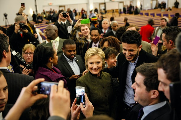 FLINT, MI - FEBRUARY 7:  Democratic Presidental candidate Hillary Clinton greets the crowd at House of Prayer on February 7, 2016 in Flint, Michigan.  Secretary Clinton briefly left the campaign trail prior to the New Hampshire primary to address the water crisis in Flint. (Photo by Sarah Rice/Getty Images)