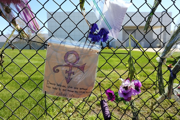 CHANHASSEN, MN - MAY 2: Tributes and memorials dedicated to Prince on the fence that surrounds Paisley Park on May 2, 2016 in Chaska, Minnesota. Prince died on April 21, 2016 at his Paisley Park compound at the age of 57. As a will has not been found, court proceedings have started to decide how his assets should be divided.   (Photo by Adam Bettcher/Getty Images)