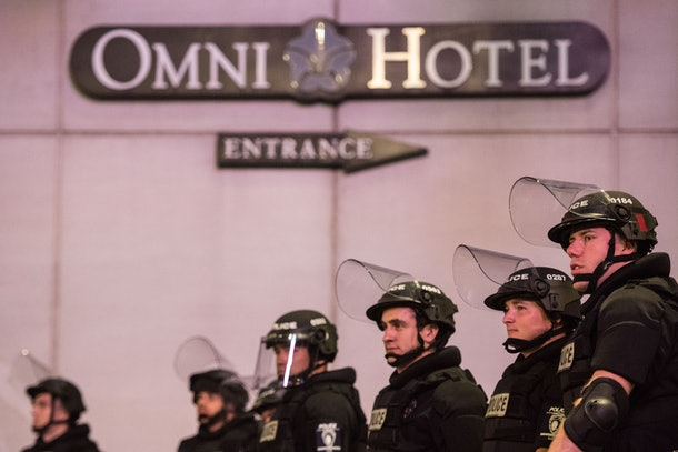 CHARLOTTE, NC - SEPTEMBER 22: Police officers watch protests near the Omni Hotel September 22, 2016 in downtown Charlotte, NC. The North Carolina governor has declared a state of emergency in the city of Charlotte after clashes during protests in the city in response to the fatal shooting by police officers of 43-year-old Keith Lamont Scott at an apartment complex near UNC Charlotte. (Photo by Sean Rayford/Getty Images)