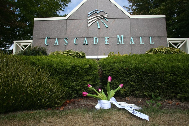 BURLINGTON, WA - SEPTEMBER 24: Flowers were placed in front of an entrance to the Cascade Mall on September 24, 2016 in Burlington, Washington. Five people were killed last night when a gunman opened fire in the shopping mall. (Photo by Karen Ducey/Getty Images)