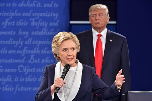 Republican presidential candidate Donald Trump listens to Democratic presidential candidate Hillary Clinton during the second presidential debate at Washington University in St. Louis, Missouri on October 9, 2016. / AFP / Paul J. Richards        (Photo credit should read PAUL J. RICHARDS/AFP/Getty Images)
