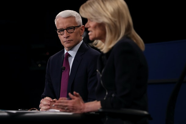 ST LOUIS, MO - OCTOBER 09:  CNN moderator Anderson Cooper (L) looks on as ABC moderator Martha Raddatz speaks during the second presidential debate with democratic presidential nominee former Secretary of State Hillary Clinton and republican presidential nominee Donald Trump at Washington University on October 9, 2016 in St Louis, Missouri. This is the second of three presidential debates scheduled prior to the November 8th election.  (Photo by Justin Sullivan/Getty Images)
