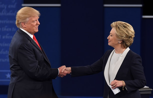 US Democratic presidential candidate Hillary Clinton and US Republican presidential candidate Donald Trump shakes hands after the second presidential debate at Washington University in St. Louis, Missouri, on October 9, 2016. / AFP / Robyn Beck        (Photo credit should read ROBYN BECK/AFP/Getty Images)