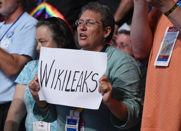 A woman holds up a sign referencing Wikileaks during Day 2 of the Democratic National Convention at the Wells Fargo Center in Philadelphia, Pennsylvania, July 26, 2016. / AFP / SAUL LOEB        (Photo credit should read SAUL LOEB/AFP/Getty Images)
