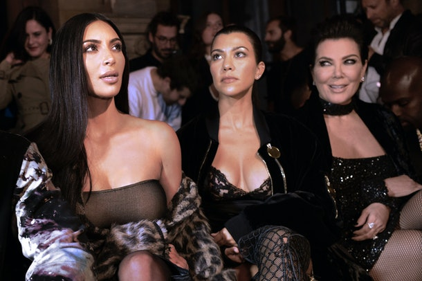 TOPSHOT - (From L) Kim Kardashian, Kourtney Kardashian and Kris Jenner attend the Off-white 2017 Spring/Summer ready-to-wear collection fashion show, on September 29, 2016 in Paris. / AFP / ALAIN JOCARD        (Photo credit should read ALAIN JOCARD/AFP/Getty Images)