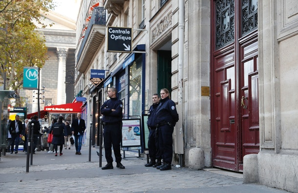 Police officers stand guard at the entrance to a hotel residence at the Rue Tronchet, near Madeleine, central Paris, on October 3, 2016, where US reality television star Kim Kardashian was robbed at gunpoint by assailants disguised as police who made off with millions, mainly in jewellery. Paris police on October 3 said that the loss amounted to 'several million euros, mostly jewellery,' adding that they were still assessing the total amount stolen and had opened an investigation. A spokesperson for the celebrity had earlier described her as 'badly shaken but physically unharmed' after the assault, which occurred late on October 2.  / AFP / Thomas SAMSON        (Photo credit should read THOMAS SAMSON/AFP/Getty Images)