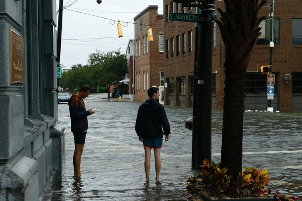 CHARLESTON, SC - OCTOBER 8:  Residents inspect and photograph the condition of the flooded streets in the area around the Charleston City Market in the wake of Hurricane Matthew on October 8, 2016 in Charleston, South Carolina. Across the Southeast, Over 1.4 million people have lost power due to Hurricane Matthew which has been downgraded to a category 1 hurricane on Saturday morning. (Photo by Brian Blanco/Getty Images)