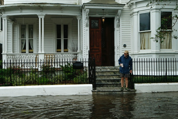 CHARLESTON, SC - OCTOBER 8:  A resident stops short of the flooded sidewalk as he makes his way to the edge of the steps in front of a friend's home on Broad St. in the wake of Hurricane Matthew on October 8, 2016 in Charleston, South Carolina. Across the Southeast, Over 1.4 million people have lost power due to Hurricane Matthew which has been downgraded to a category 1 hurricane on Saturday morning. (Photo by Brian Blanco/Getty Images)
