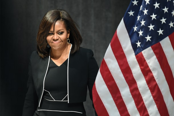 TOPSHOT - US First Lady Michelle Obama speaks during a 'Let Girls Learn' event during the Spring Meetings of the World Bank Group and the International Monetary Fund in Washington, DC, April 13, 2016. / AFP / Jim Watson        (Photo credit should read JIM WATSON/AFP/Getty Images)