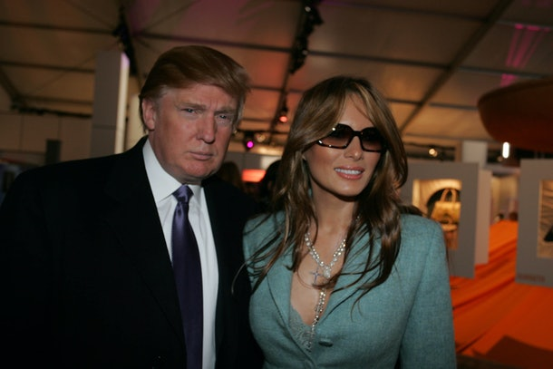 NEW YORK - FEBRUARY 09:  Donald and Melania Trump pose for photos in the lobby of the main tent during Olympus Fashion Week Fall 2005 at Bryant Park February 9, 2005 in New York City. (Photo by Katy Winn/Getty Images)