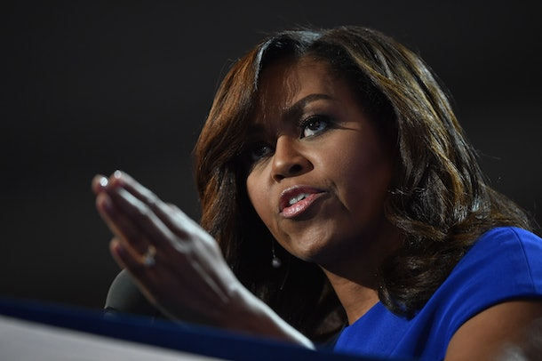 US First Lady Michelle Obama addresses delegates on  Day 1 of the Democratic National Convention at the Wells Fargo Center in Philadelphia, Pennsylvania, July 25, 2016. / AFP / Nicholas Kamm        (Photo credit should read NICHOLAS KAMM/AFP/Getty Images)
