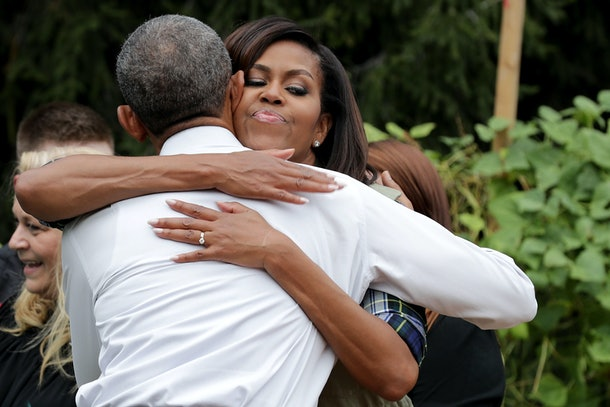 WASHINGTON, DC - OCTOBER 06:  U.S. first lady Michelle Obama embraces President Barack Obama during an event to harvest the White House Kitchen Garden on the South Lawn of the White House October 6, 2016 in Washington, DC. Students from across the country were invited to help pull vegetables and greens from the garden which was established by the first lady in the spring of 2009. The garden is now a permanent feature on the White House grounds.  (Photo by Chip Somodevilla/Getty Images)