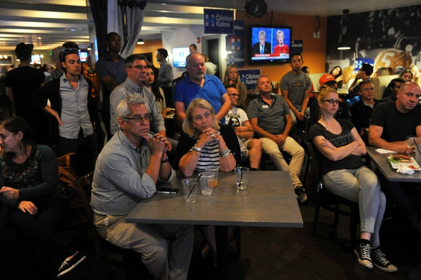 Supporters of Democratic presidential nominee Hillary Clinton watch the first presidential debates during a Debate Watch Party at Jake's Sports & Spirits in Denver, Colorado on September 26, 2016.  / AFP / Jason Connolly        (Photo credit should read JASON CONNOLLY/AFP/Getty Images)