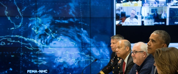 US President Barack Obama (2nd R) speaks about Hurricane Matthew with Assistant to the President for Homeland Security and Counterterrorism Lisa Monaco (R), FEMA Administrator Craig Fugate (3rd R), Secretary of Homeland Security Jeh Johnson (4th R) and Commanding General and Chief of Engineers US Army Lieutenant General Todd Semonite (5th R) after receiving a briefing at the Federal Emergency Management Agency (FEMA) Headquarters in Washington, DC, October 5, 2016. / AFP / JIM WATSON        (Photo credit should read JIM WATSON/AFP/Getty Images)