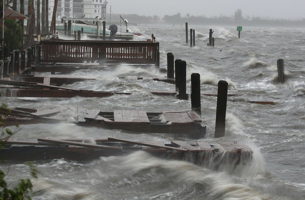COCOA BEACH, FL - OCTOBER 07: Heavy waves caused by Hurricane Matthew pound the boat docks at the Sunset Bar and Grill, October 7, 2016 on Cocoa Beach, Florida. Hurricane Matthew passed by offshore as a catagory 3 hurricane bringing heavy winds and minor flooding.  (Photo by Mark Wilson/Getty Images)