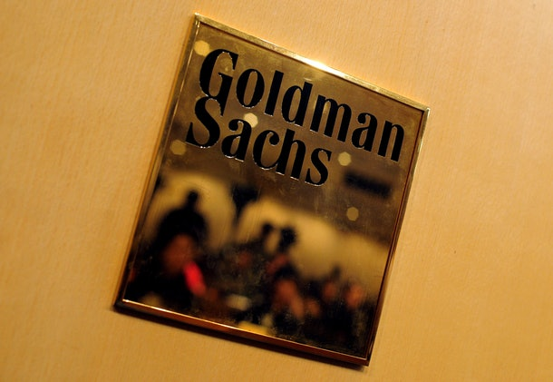In this November 15, 2009 photograph, a plaque for investment banking giant Goldman Sachs at a press conference in Hong Kong. Asian stocks tumbled on April 19, 2010 as financial firms were hit by news that Wall Street giant Goldman Sachs had been charged with misleading investors.  AFP PHOTO / RICHARD A. BROOKS        (Photo credit should read RICHARD A. BROOKS/AFP/Getty Images)