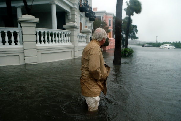 CHARLESTON, SC - OCTOBER 8:   A resident emerges from his home to inspect the flooding near White Point Gardens in the wake of Hurricane Matthew on October 8, 2016 in Charleston, South Carolina. Across the Southeast, Over 1.4 million people have lost power due to Hurricane Matthew which has been downgraded to a category 1 hurricane on Saturday morning. (Photo by Brian Blanco/Getty Images)