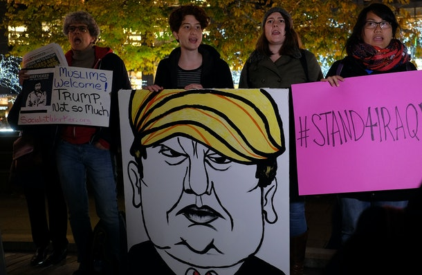 Human rights activists and people from the Muslim community display a placard depicting US presidential hopeful Donald Trump during a demonstration in New York on December 10, 2015 in solidarity for Syrian and Iraqi refugees. AFP PHOTO/JEWEL SAMAD / AFP / JEWEL SAMAD        (Photo credit should read JEWEL SAMAD/AFP/Getty Images)