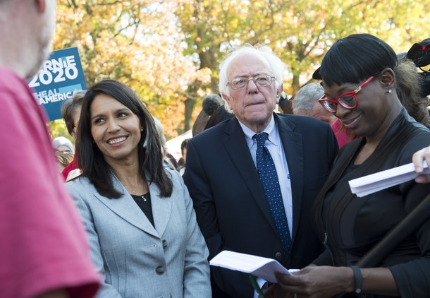 US Senator Bernie Sanders, (I-VT), waits alongside US Representative Tulsi Gabbard (L), Democrat of Hawaii, to speak during a rally to stop the Trans-Pacific Partnership (TPP) organized by National Nurses United and the People for Bernie Sanders, on Capitol Hill in Washington, DC, November 17, 2016. / AFP / SAUL LOEB        (Photo credit should read SAUL LOEB/AFP/Getty Images)