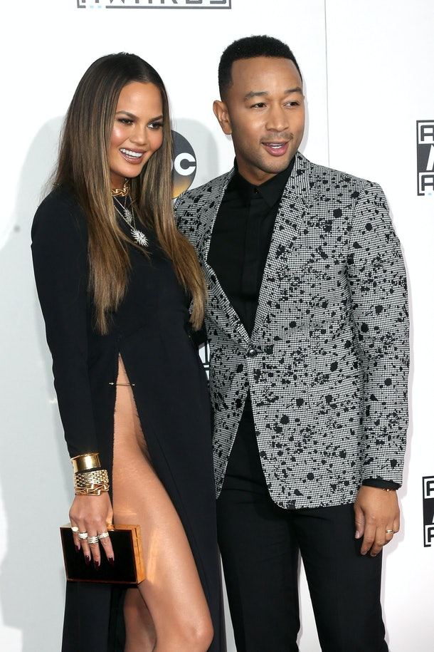 LOS ANGELES, CA - NOVEMBER 20:  Model Chrissy Teigen (L) and singer-songwriter John Legend attend the 2016 American Music Awards at Microsoft Theater on November 20, 2016 in Los Angeles, California.  (Photo by Frederick M. Brown/Getty Images)