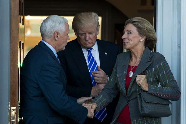 BEDMINSTER TOWNSHIP, NJ - NOVEMBER 19: (L to R) Vice president-elect Mike Pence, president-elect Donald Trump and Betsy DeVos  leave the clubhouse after their meeting at Trump International Golf Club, November 19, 2016 in Bedminster Township, New Jersey. Trump and his transition team are in the process of filling cabinet and other high level positions for the new administration.  (Photo by Drew Angerer/Getty Images)