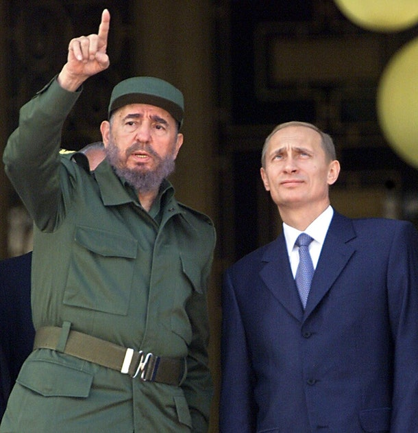 Cuban President Fidel Castro (L) gestures while he speaks with Russia's President Vladimir Putin, 14 December, 2000, at the Palace of the Revolution in Havana. Putin is the first Russian leader to visit the island since the fall of the Soviet bloc.   AFP PHOTO/ADALBERTO ROQUE (Photo credit should read ADALBERTO ROQUE/AFP/Getty Images)