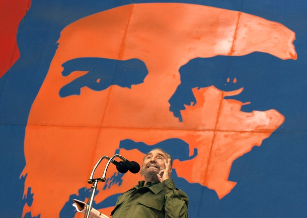 The President of Cuba, Fidel Castro, delivers a speech with a poster of revolutionary leader Ernesto Che Guevara on the background, during the opening of the 1st ALBA Games, 17 June 2005 at Havana's Coliseum. Sportsmen from nineteen different countries will take part in the event, which was organized by the Cuban and Venezuelan governments in order to promote cultural relations between Latin America and that runs until June 30th.    AFP PHOTO/Adalberto ROQUE / AFP / ADALBERTO ROQUE        (Photo credit should read ADALBERTO ROQUE/AFP/Getty Images)
