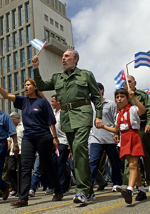 (FILE) Cuban President Fidel Castro (C) leads a march, 01 May 2001, past the United States Interests Section's building in Havana, where thousands of Cubans joined to celebrate Labor Day. 'Fidel underwent surgery from which he is recovering satisfactorily,' Health Minister Jose Ramon Balaguer said on August 4th, 2006, during a visit to Guatemala, refusing to say more about Castro's health following an operation to stem intestinal bleeding at the beginning of the week. Cuba insisted Friday that Raul Castro was in control and his brother Fidel was recovering from surgery, as the Communist leaders stayed out of view but defiant against escalating US calls for democratic change.   AFP PHOTO/ADALBERTO ROQUE / AFP / ADALBERTO ROQUE        (Photo credit should read ADALBERTO ROQUE/AFP/Getty Images)