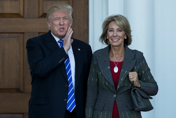 BEDMINSTER TOWNSHIP, NJ - NOVEMBER 19: (L to R) president-elect Donald Trump and Betsy DeVos  pose for a photo after their meeting at Trump International Golf Club, November 19, 2016 in Bedminster Township, New Jersey. Trump and his transition team are in the process of filling cabinet and other high level positions for the new administration.  (Photo by Drew Angerer/Getty Images)