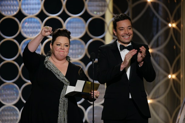 BEVERLY HILLS, CA - JANUARY 12:  In this handout photo provided by NBCUniversal, Presenters Melissa McCarthy and Jimmy Fallon speak onstage during the 71st Annual Golden Globe Award at The Beverly Hilton Hotel on January 12, 2014 in Beverly Hills, California.  (Photo by Paul Drinkwater/NBCUniversal via Getty Images)