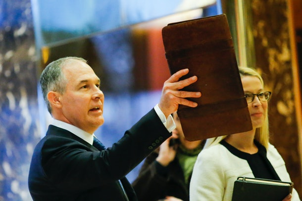 Oklahoma AG Scott Pruitt (L) arrives for meetings with President-elect Donald Trump November 28, 2016 at Trump Tower in New York
