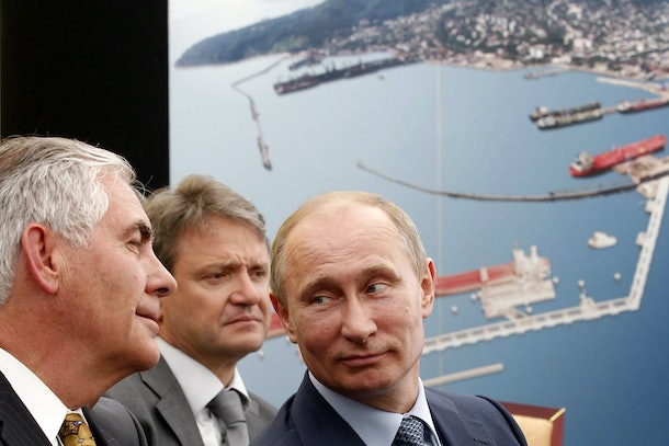 Russia's President Vladimir Putin (R) and ExxonMobil Chairman and CEO Rex Tillerson (L) attend at the ceremony of the signing of an agreement between state-controlled Russian oil company Rosneft and ExxonMobil in the Black Sea port of Tuapse on June 15, 2012.