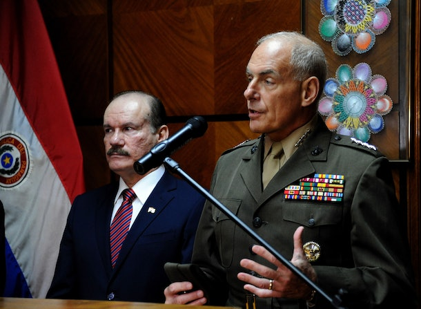 US Southern Command commander General John F. Kelly (R) speaks next to Paraguayan Defence Minister Bernardino Soto Estigarribia during a press conference on July 30, 2014 at the National Defense Ministry  in Asuncion. Kelly is in Paraguay in a three-day official visit.
