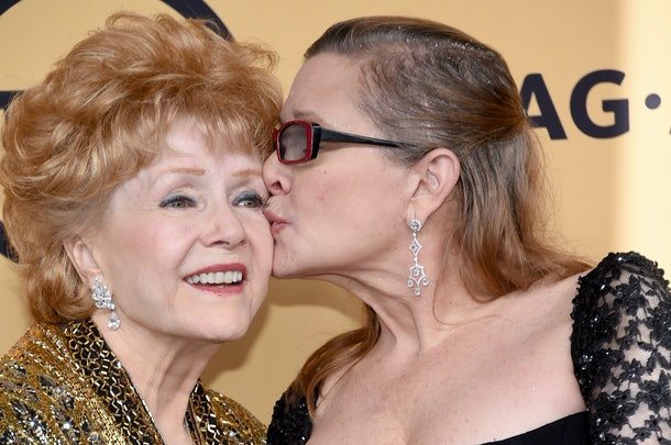 LOS ANGELES, CA - JANUARY 25:  Actresses Debbie Reynolds (L), recipient of the Screen Actors Guild Life Achievement Award, and Carrie Fisher pose in the press room at the 21st Annual Screen Actors Guild Awards at The Shrine Auditorium on January 25, 2015 in Los Angeles, California.  (Photo by Ethan Miller/Getty Images)