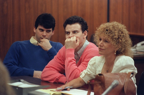 Erik Menendez (C) and his brother Lyle (L) are pictured, on August 12, 1991 in Beverly Hills. They are accused of killing their parents, Jose and Mary Louise Menendez of Beverly Hills, Calif. AFP PHOTO Mike NELSON (Photo credit should read