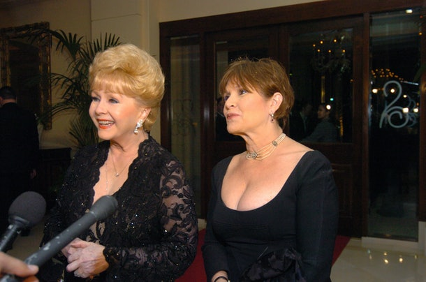 HENDERSON, NV - FEBRUARY 27:  In this handout photo provided by the Las Vegas News Bureau, Carrie Fisher and her mother, Debbie Reynolds are interviewed at The Ritz-Carlton, Lake Las Vegas, as they arrive to celebrate Dame Elizabeth Taylor's 75th birthday on February 27, 2007 in Henderson, Nevada.  (Photo by Brian Jones/Las Vegas News Bureau via Getty Images)