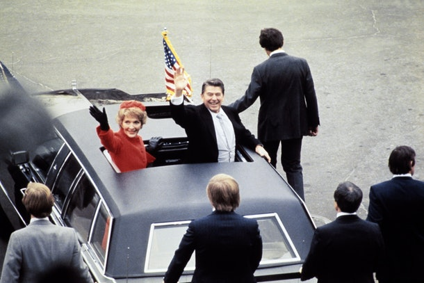 US President Ronald Reagan (C) salutes beside his wife Nancy Reagan after being sworn in as 40th President of the United States by Chief Justice Warren Burger during inaugural ceremony, on January 20, 1981 at the Capitol in Washington, DC.        (Photo credit should read -/AFP/Getty Images)