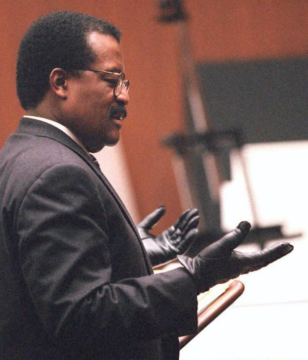 LOS ANGELES, CA - SEPTEMBER 27:  Defense lawyer Johnnie Cochran Jr. puts on gloves 27 September while he addresses the jury during closing arguments during the O.J. Simpson double murder trial.  Cochran used the gloves to remind the jurors that the ones Simpson tried on did not fit.  (Photo credit should read HAL GARB/AFP/Getty Images)