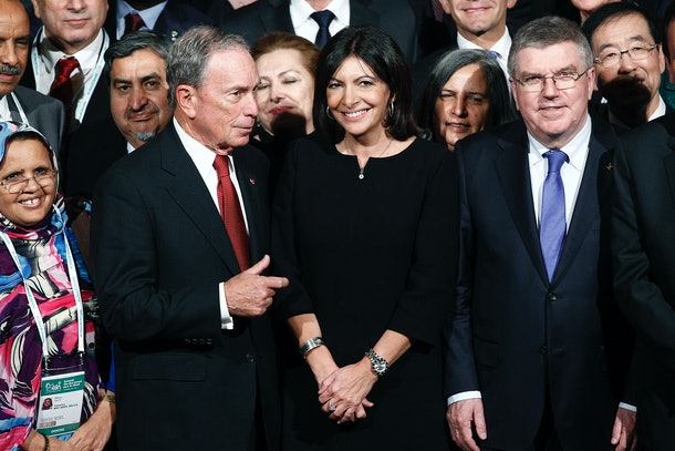 PARIS, FRANCE - DECEMBER 04:  Former Mayor of New York City, Michael Bloomberg and Mayor of Paris, Anne Hidalgo pose with thousand mayors from different cities at the Paris city hall during the Summit of Local elected for Climate at the Paris city hall on December 04, 2015 in Paris, France. Thousand mayors from different cities gather at the Paris city hall during the COP21, Paris Climate Conference.  (Photo by Thierry Chesnot/Getty Images)