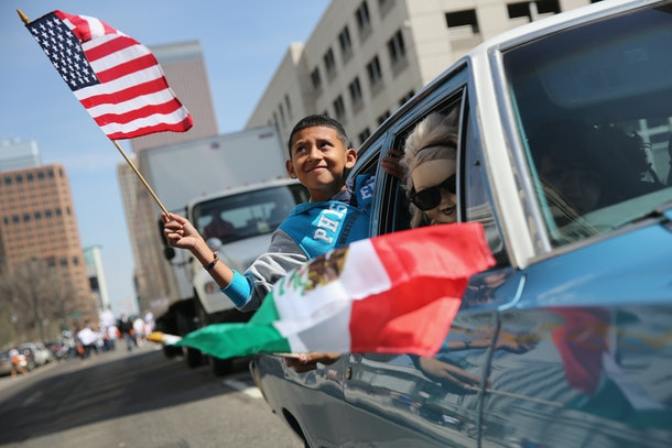 DENVER, CO - MAY 04:  A boy rides in a low rider during a Cinco de Mayo parade  on May 4, 2013 in Denver, Colorado. Hundreds of thousands of people were expected to attend the two day event, billed as the largest Cinco de Mayo celebration in the United States. Cinco de Mayo observes the victory of the Mexican army over French forces on May 5, 1862 in the town of Puebla, Mexico. The festival celebrates Mexican culture and is one of the most popular annual Latino events in the United States.  (Photo by John Moore/Getty Images)