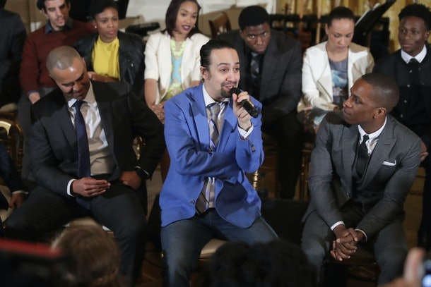 WASHINGTON, DC - MARCH 14:  Members of the Broadway cast of HAMILTON, including (L-R) Christopher Jackson, creator and star Lin-Manuel Miranda and Leslie Odom Jr., conduct a question-and-answer session with students in the East Room of the White House March 14, 2016 in Washington, DC. Members of the cast participated in a student workshop, student question-and-answer session and a performance of selections from the award winning musical.  (Photo by Chip Somodevilla/Getty Images)