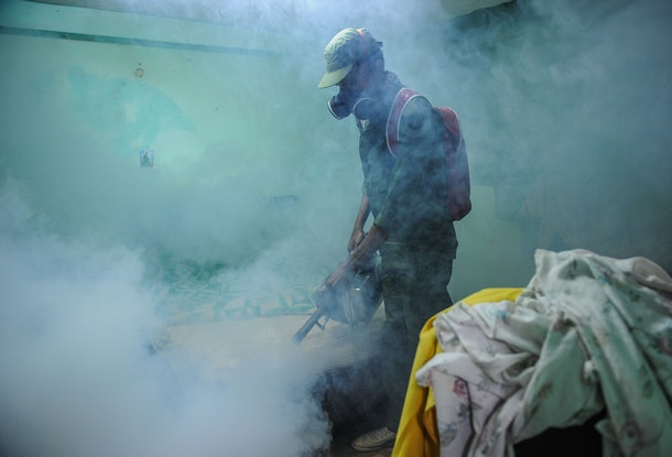 A member of the Cuban army fumigates against the Aedes aegypti mosquito to prevent the spread of zika, chikungunya and dengue, in Havana, on February 23, 2016. Cuban President Raul Castro announced Monday that 9,200 troops and police have been mobilized in a campaign to eliminate mosquitoes and protect the country against the Zika virus. Cuba has not officially recorded any cases of the mosquito-borne virus, which is strongly suspected of causing serious birth defects in babies born to infected mothers. But 28 countries and territories in the Americas and the Caribbean have reported cases of active Zika transmission, with 1.5 million in Brazil, the hardest-hit country.  AFP PHOTO / YAMIL LAGE / AFP / YAMIL LAGE        (Photo credit should read YAMIL LAGE/AFP/Getty Images)