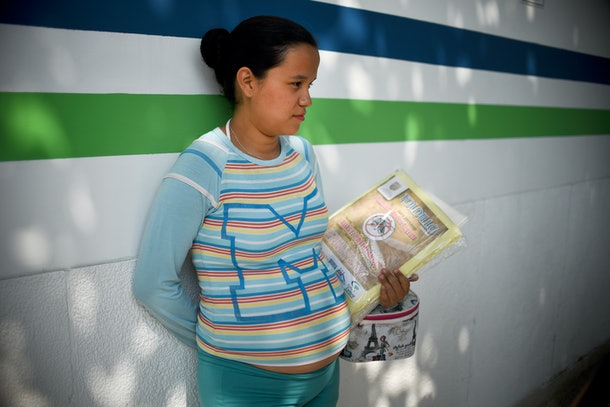 A pregnant woman holds a mosquito net in Cali on February 10, 2016. The  Colombian Health Ministry began delivering mosquito nets for free to pregnant women to prevent the infection by Zika virus, vectored by the Aedes aegypti mosquito. The World Health Organization on Tuesday urged caution about linking the Zika virus with a rare nerve disorder called Guillain-Barre which health officials in Colombia have blamed for three deaths.  AFP PHOTO / LUIS ROBAYO / AFP / LUIS ROBAYO        (Photo credit should read LUIS ROBAYO/AFP/Getty Images)
