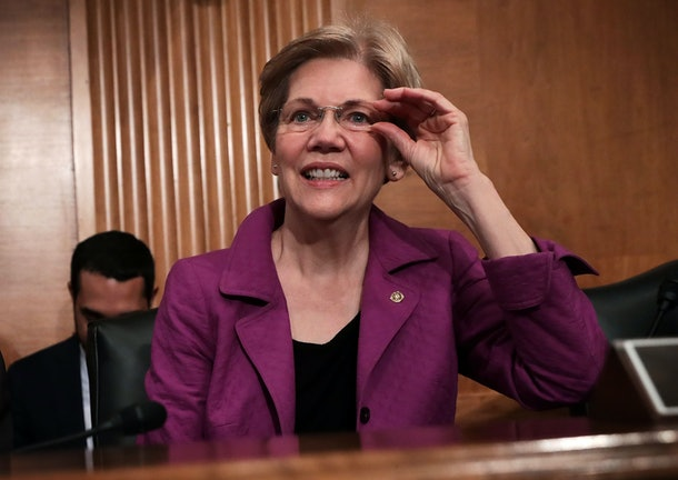 WASHINGTON, DC - APRIL 07:  U.S. Sen. Elizabeth Warren (D-MA) waits for the beginning of a hearing before the Senate Banking, Housing and Urban Affairs Committee April 7, 2016 on Capitol Hill in Washington, DC. The committee held a hearing on 'The Consumer Financial Protection Bureau's Semi-Annual Report to Congress.'  (Photo by Alex Wong/Getty Images)