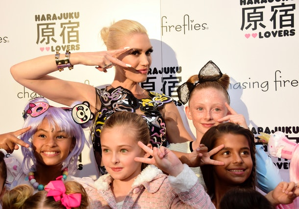 WEST HOLLYWOOD, CA - SEPTEMBER 24:  Singer Gwen Stefani poses with children at a party hosted by Chasing Fireflies to introduce her Harajuku Lovers children's collection at Duff's Cakemix on September 24, 2015 in West Hollywood, California.  (Photo by Frazer Harrison/Getty Images for Chasing Fireflies)