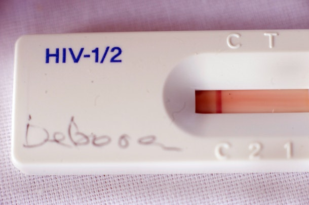 A used HIV's test kit shows a negative result at a roadside AIDS testing table in Langa, a suburb of Cape Town, during the world AIDS Day on December 1, 2010.  A million people are now receiving anti-AIDS drugs in South Africa, a country with the world's heaviest HIV infections, Deputy President Kgalema Motlanthe said. South Africa has 5.6 million people who are HIV-positive out of a 50-million population, according to UN estimates. AFP PHOTO / RODGER BOSCH        (Photo credit should read RODGER BOSCH/AFP/Getty Images)