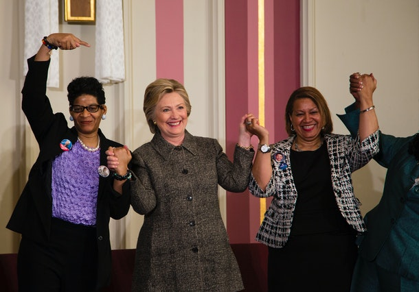 MILWAUKEE, WI - MARCH 29: Democratic presidential candidate Hillary Clinton (C), Annette Holt (R), and Geneva Reed-Veal (L) join hands at a Community Forum on Gun Violence Prevention held at Tabernacle Baptist Church on March 29, 2016 in Milwaukee, Wisconsin. Clinton is campaigning in Wisconsin ahead of the state's April 5th primary. (Photo by Darren Huack/Getty Images)