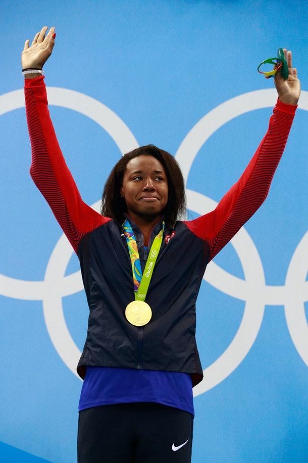 RIO DE JANEIRO, BRAZIL - AUGUST 11:  Gold medalist Simone Manuel of the United States celebrates on the podium during the medal ceremony for the Women's 100m Freestyle Final on Day 6 of the Rio 2016 Olympic Games at the Olympic Aquatics Stadium on August 11, 2016 in Rio de Janeiro, Brazil.  (Photo by Adam Pretty/Getty Images)